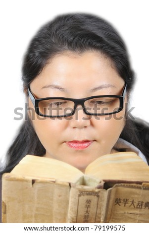 Young Asian woman reading. Wearing eyeglasses