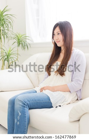 young asian woman relaxing on the sofa