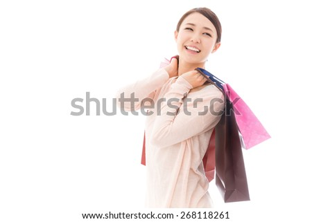 young asian woman shopping image on white background - stock photo