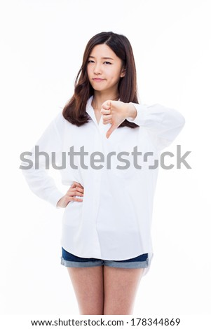 Young Asian woman show bad sign isolated on white background.  - stock photo