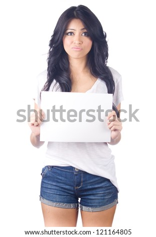 Young asian woman showing empty blank paper card sign with copy space for text on white isolated