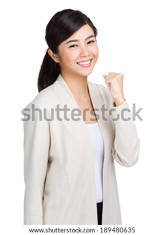Young asian woman showing fist - stock photo