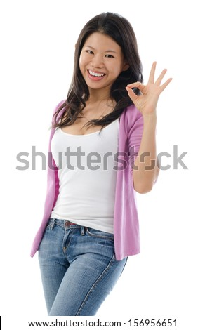 Young Asian woman showing okay hand sign with great smile standing isolated on white background. Southeast Asian woman model. - stock photo