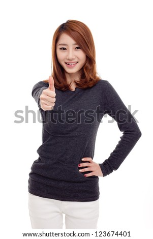 Young Asian woman showing thumb isolated on white background. - stock photo