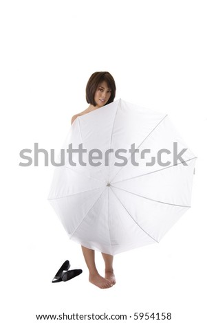 Young Asian woman standing behind white umbrella with bare feet on a white background - stock photo