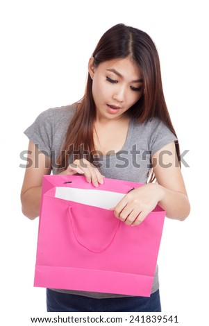 Young Asian woman surprise look inside shopping bag  isolated on white background