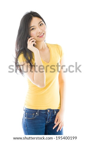 Young Asian woman talking on a mobile phone - stock photo