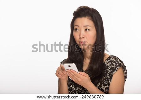 Young Asian woman texting cell phone smart phone