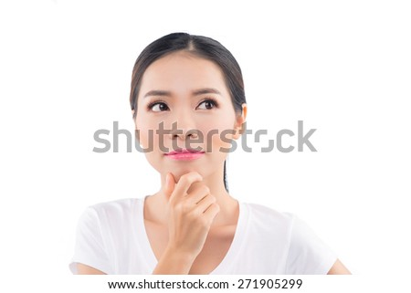 Young asian woman think. Asian beauty woman skin care close-up. Beautiful young woman touching her face looking to the side. Isolated on white background. Mixed race Asian / Caucasian model. - stock photo