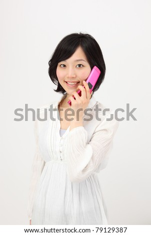 Young asian woman to call - stock photo