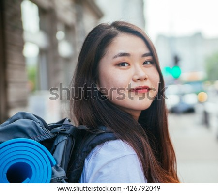Young Asian Woman Tourist Looking At The Camera - stock photo