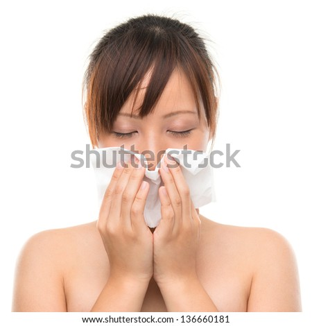 Young Asian woman using a facial tissue, isolated on white - stock photo