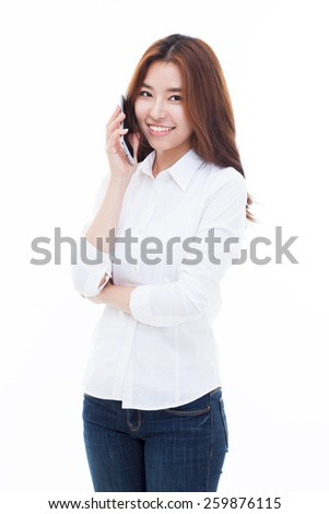 Young Asian woman using a smart phone isolated on white background.  - stock photo
