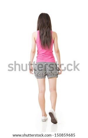 Young asian woman walking. Rear view. Isolated on the white background. - stock photo