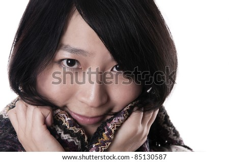 Young asian woman wearing a shawl on white - stock photo