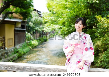 young asian woman wearing kimono walking - stock photo
