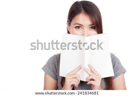 Young Asian woman with a book over her mouth  isolated on white background