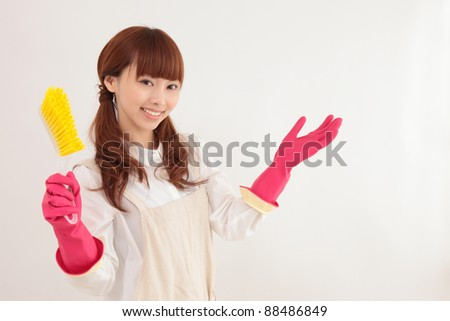 Young Asian woman with a cleaning tool - stock photo