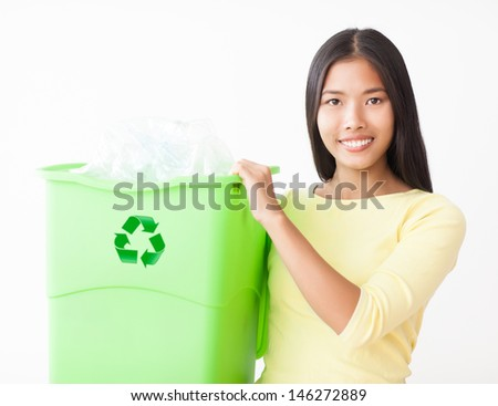 Young Asian woman with a crate full of plastic bottles for recycling.