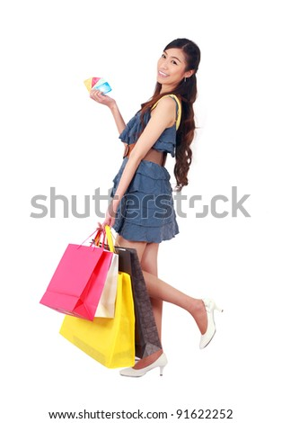 Young asian woman  with a credit card and shopping bags on white - stock photo
