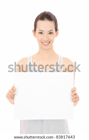 Young Asian woman with an empty board - stock photo