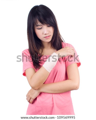 Young asian woman with an injured arm wrapped in an Elastic Bandage - stock photo