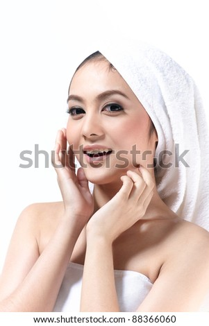 Young asian woman with beautiful and clean face - stock photo