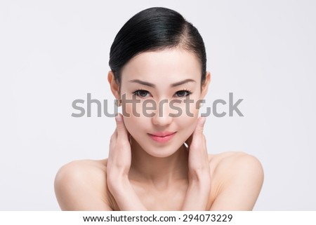 Young Asian woman with beautiful face and clear skin - stock photo