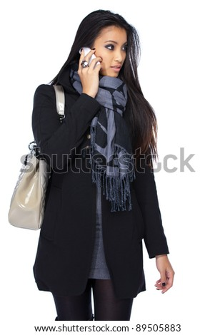 young asian woman with cellphone isolated on white - stock photo