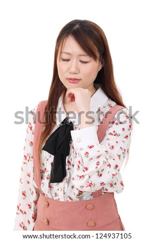 Young asian woman with her hands up by her face with her eyes closed - stock photo