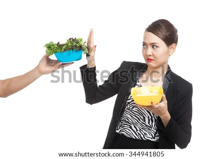 Young Asian woman with potato chips say no to salad  isolated on white background - stock photo