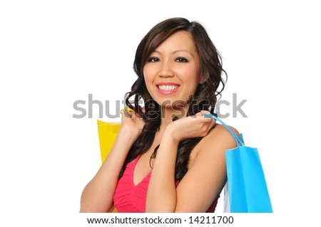 Young asian woman with shopping bags isolated on white