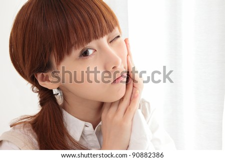Young Asian woman with toothache - stock photo