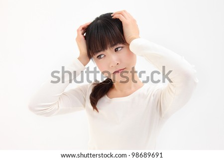 Young Asian women facing the head of the white background - stock photo
