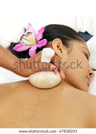 young asian women getting thai herbal massage - stock photo