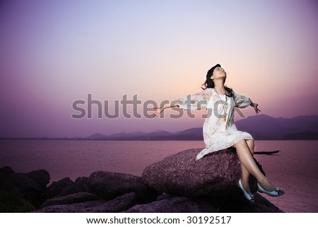young asian women relax on rock - stock photo