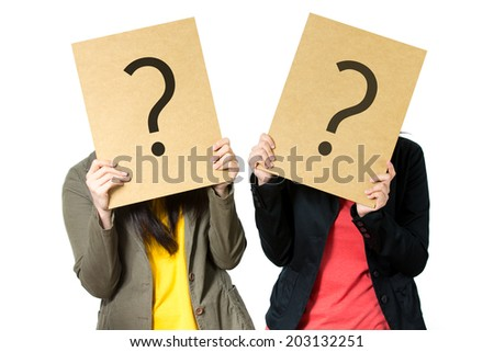 young asian women with interrogation symbols on her face - stock photo