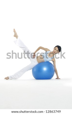 young Asian women working out with gym ball