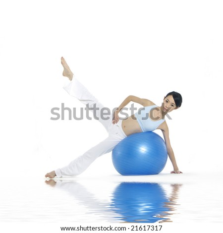 young asian women working out with gym ball with reflection
