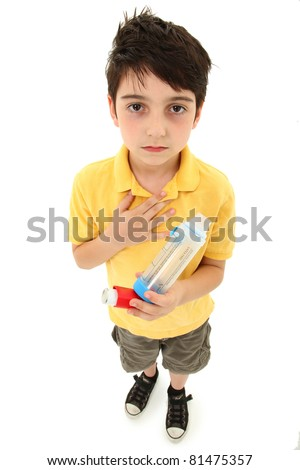 Young asthmatic child with inhaler and spacer chamber over white background. Periorbital hyperpigmentation. - stock photo