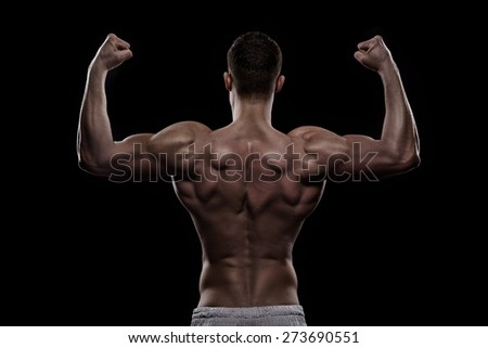 young athlete bodybuilder from back isolated over black background