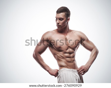 young athlete bodybuilder man isolated over white background - stock photo