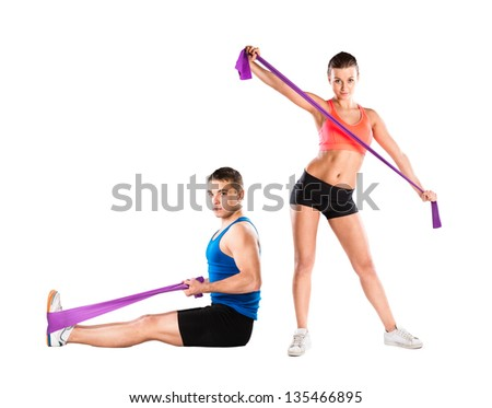 Young athlete doing exercises with a resistance band - stock photo