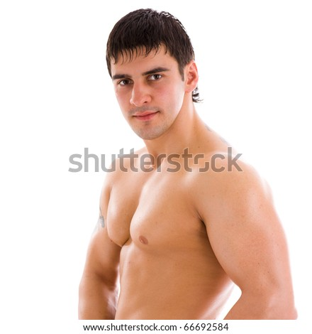 Young athlete man looking at you isolated on white