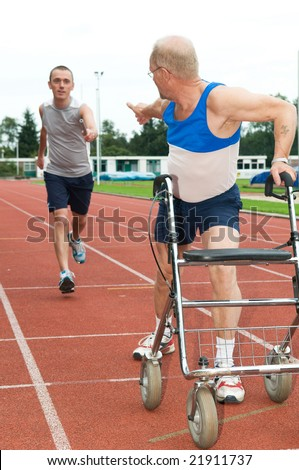 Young athlete reaching for a disabled athlete to pass him the baton. Caricature picture to illustrate helping, giving, disability, ability, getting older, not wanna quit. - stock photo