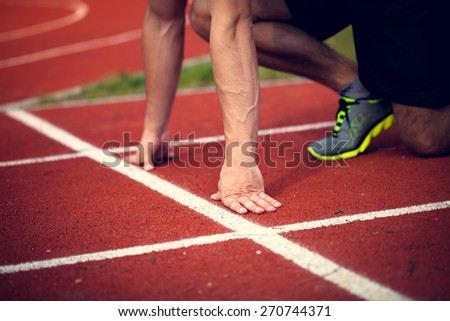 Young athlete ready to start - stock photo