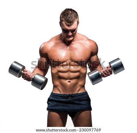 Young athlete trains biceps silver dumbbells - stock photo