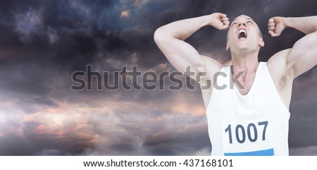 Young athlete winning race against gloomy sky - stock photo