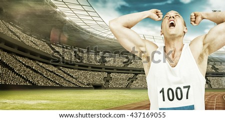 Young athlete winning race against view of a stadium - stock photo