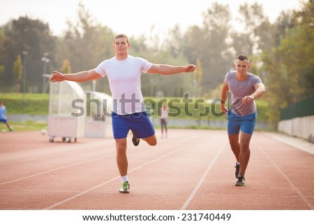 Young athlete winning the race - stock photo